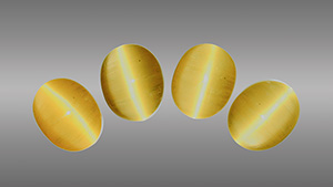 Four cat's-eye heliodor cabochons.