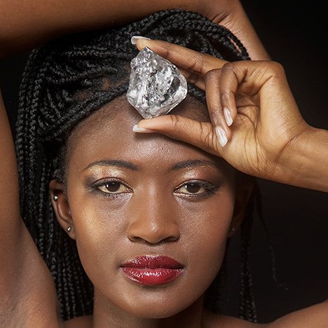 Model posing with Lesotho Promise diamond