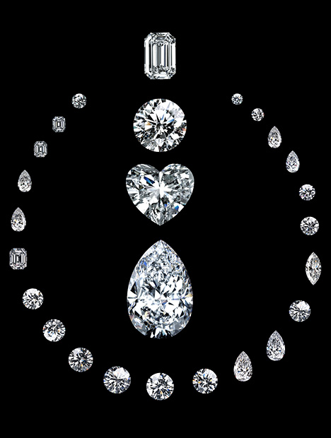 Diamonds cut from the Lesotho Promise are arranged in the shape of a necklace, which surrounds an emerald cut, round brilliant cut, heart-shaped and pear-shaped diamonds.