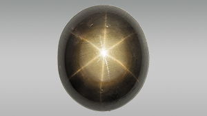 Black star sapphire enhanced with lead glass