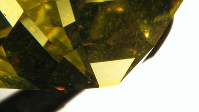 Color concentration along a diamond's culet, evidence of irradiation