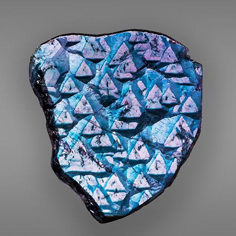 Trigonal growth features on a blue cap tourmaline termination