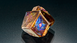 Iridescent andradite garnet from Japan with an iridescent andradite inclusion.