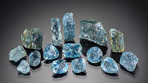 Rough and faceted Nigerian aquamarine.