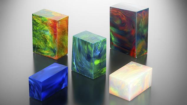 Imitation opal blocks display play-of-color phenomenon.