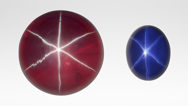 A large synthetic star ruby, left, and smaller synthetic star sapphire.