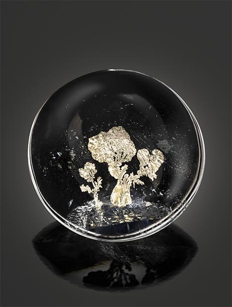 Tree-like metal sulfide inclusion in quartz.