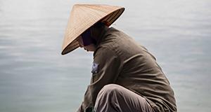 Vietnamese pearl farm employee at Hạ Long Bay