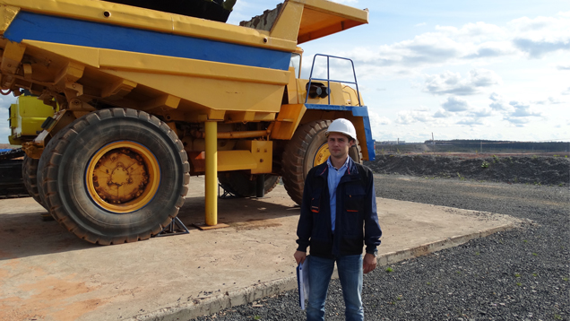 Ilya Zezin stands in front of a truck that is now a monument.