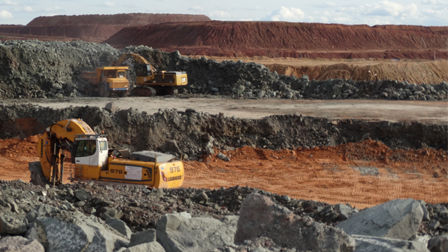 Mounds of kimberlite are stockpiled by the dump truck load.