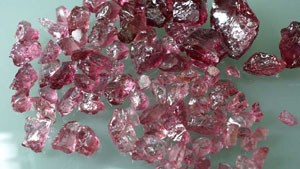 Spinel rough from Tajikistan, the largest stone (upper right) weighing 242.50ct.