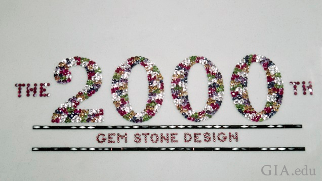 "The gems spell out ""The 2000th Gem Stone Design."""