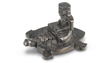 A figure of a man sitting cross-legged on the back of a large turtle, carved into diamond.