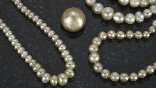 Several natural pearl strands and a large single pearl from the Arabian Gulf