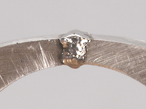 Platinum ring shank joint, overfilled with platinum cobalt after laser welding.