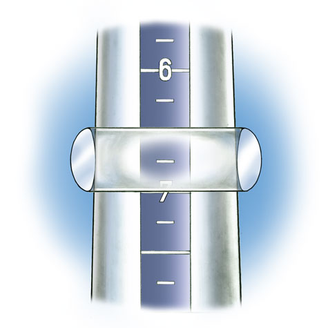 Close-up view of flat-top band positioned on plastic ring mandrel to check ring size. In this illustration the band is transparent so that the size is visible.