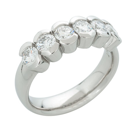 Perspective view of a substantial platinum ring with six matching partial-bezel set stones