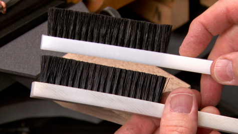 Two platinum work brushes; the top brush has natural bristles