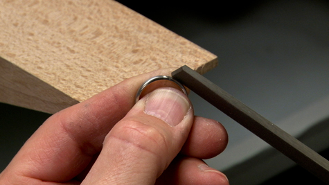 Filing a platinum ring with a file