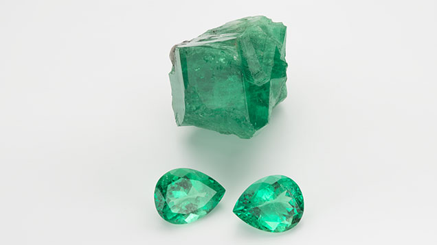 An 887 ct emerald rough and 95.51 ct twt pear shape emeralds from Muzo, Columbia. Courtesy: Manual Marcial de Gomar.