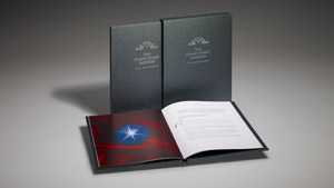 Monograph hardcover book open with sapphire images and hardcover slip case, GIA report enclosed.