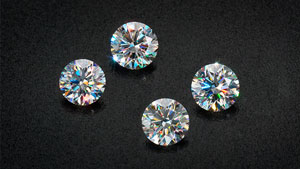 These round brilliant diamonds have small areas on the pavilion etched with diffraction gratings that increase their apparent fire.