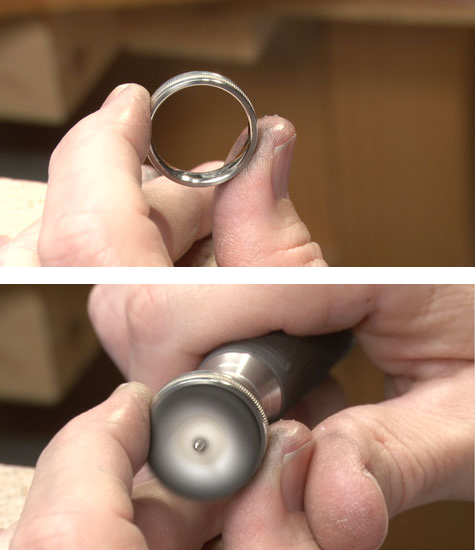 Jeweler holding a platinum band at the bench, in preparation for buffing