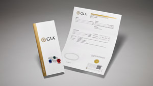 GIA Pearl Classification Report with main components of the report on display, and colored stones and pearls on the front cover.