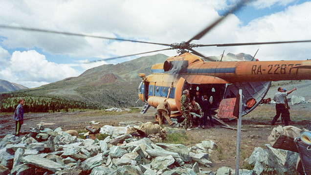 Helicopter landing in rugged Siberian terrain