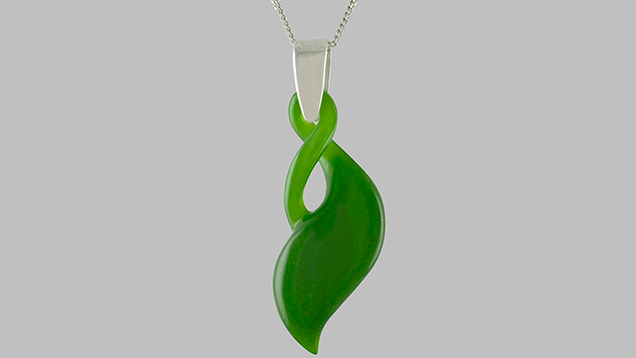 Carved nephrite pendant with graceful curves