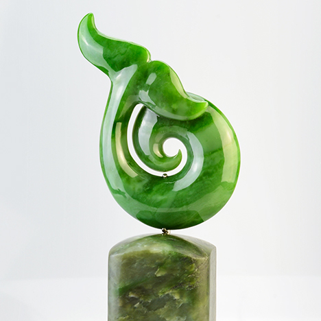 Green nephrite sculpted whale's tail