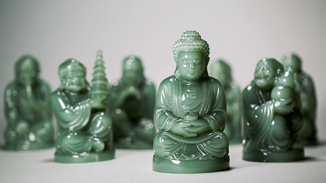 Suite of Buddhist figures carved from Siberian nephrite