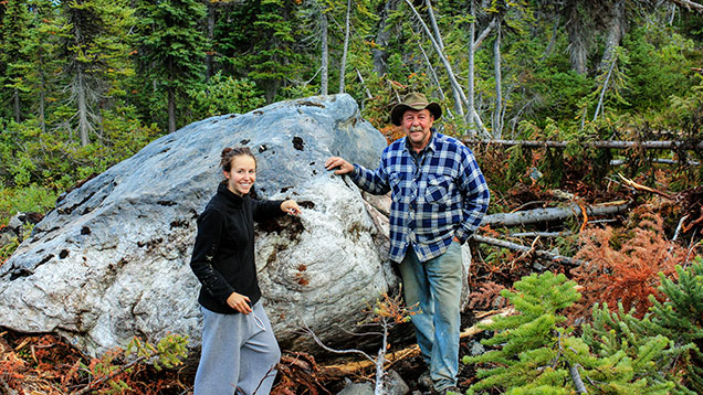 Makepeace and daughter near a large nephrite boulder
