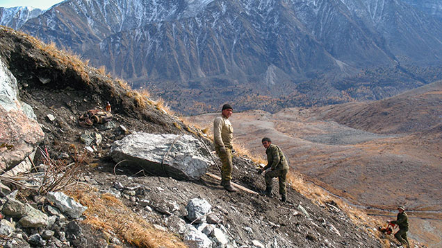 Miners on a mountainside in Siberia