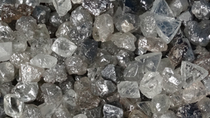 A close-up image of a pile of rough diamonds.