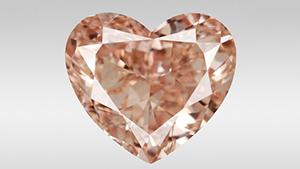 ファンシーで強烈なピンクがかったオレンジ色のダイヤモンド