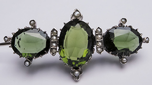 Silver brooch with glass