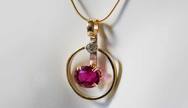 Gold and tourmaline pendant