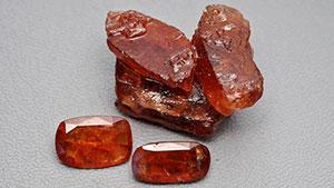 Three rough hessonite samples