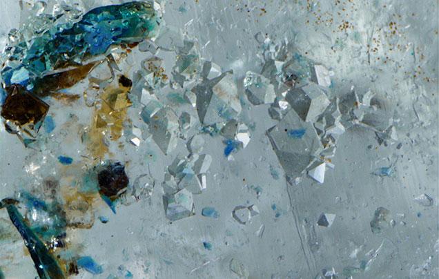 Lazulite inclusions using partial immersion technique