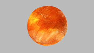 Orange color and aventurescence in scapolite