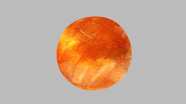 Orange color and aventurescence in scapolite