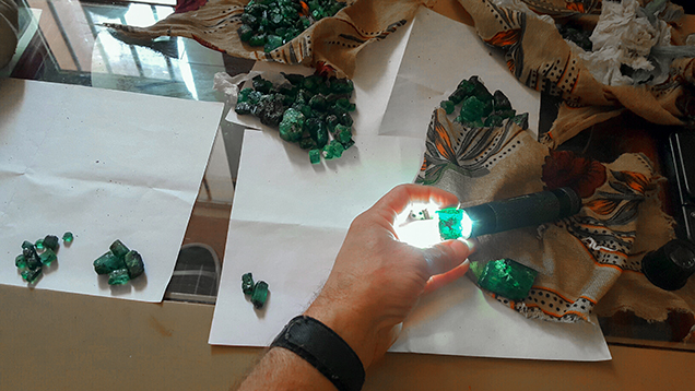 Michael Nemeth sorts Ethiopian emerald