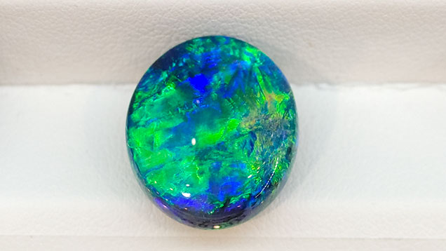 Black opal cabochon from Lightning Ridge