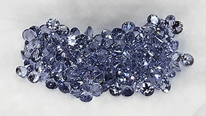 Small unheated spinel and sapphire exhibited by Madagascar Imports