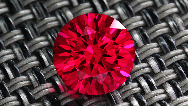 The Geometeer, a synthetic ruby with a hybrid cut by Rex Guo.