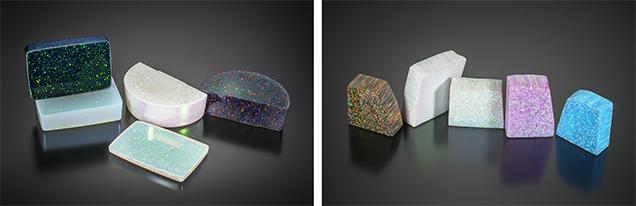 Plastic opal imitation by Kyocera alongside the company's polymer-impregnated synthetic opal.