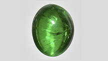 Cat's-eye demantoid with well-aligned horsetail inclusions.