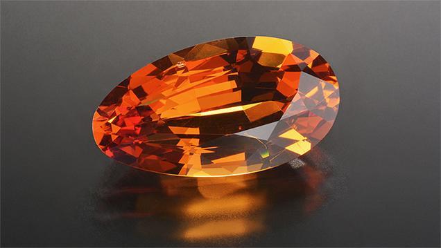 Orange pear-shaped pyrope-spessartine-grossular garnet.