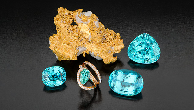Paraíba-type tourmalines from Mozambique alongside gold nugget.